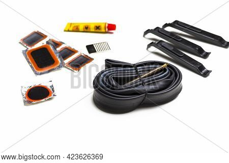 Road Cycling Concepts. Complete Set Of Road Bike Inner Tube Repairing Kit Against White.horizontal I