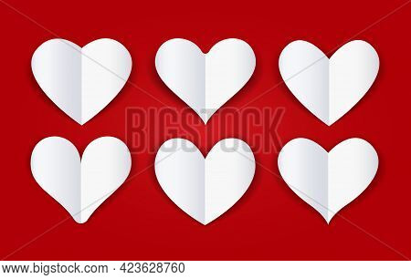 Cutout Paper Folded Hearts. White Papers Cut Fold Heart Shapes On Cardboard Red Burgundy Background