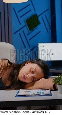 Businesswoman Sleeping On Desk While Working At Accounting Statistics In Business Company Office Lat