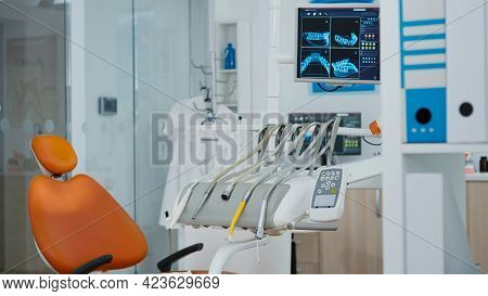 Close Up Revealing Shot Of Medical Orthodontist Monitor With Teeth X Ray Images On It. Empty Modern