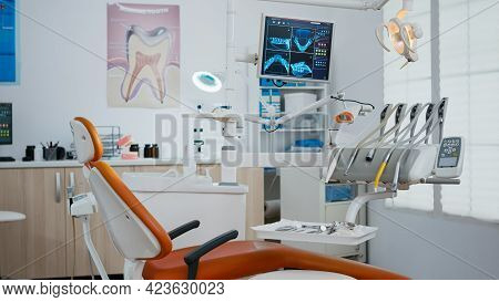 Interior Of Modern Dental Office In Hospital With Dentistry Orthodontic Furniture. Zoom In Shot Of P