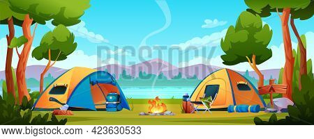 Campfire, Camping Hiking Tents Forest Nature Scenery, River Or Lake, Mountains On Background. Bonfir