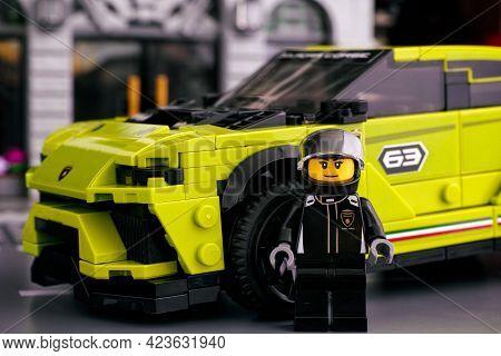 Tambov, Russian Federation - June 24, 2020 Lego Driver Minifigure Standing Against Lamborghini Urus