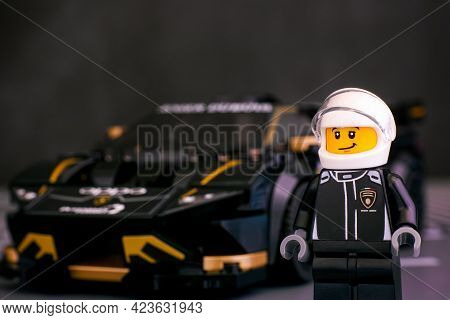 Tambov, Russian Federation - June 25, 2020 Lego Driver Minifigure Against Lamborghini Huracan Super