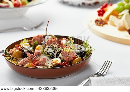 Nicoise Salad On The Banquet Table, Classic Nicoise Salad Served By The Chef In A Craft Plate, Tuna