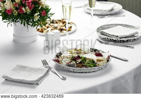 Vitello Tonnato, On A Table With White Tablecloths, Banquet Table. Dish With Marinated Veal With Cre