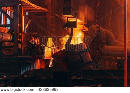 Liquid Iron Molten Metal Pouring From Ladle Into Mold, Industrial Metallurgical Factory, Foundry Cas