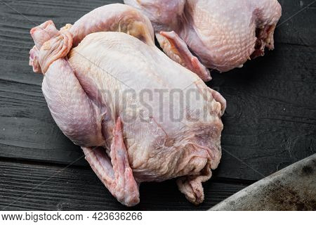 Raw Organic Uncooked Whole Chicken Meat, On Black Wooden Background