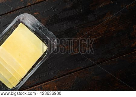 Pieces Of Cheddar Cheese Set, In Plastic Pack, On Old Dark  Wooden Table Background, Top View Flat L