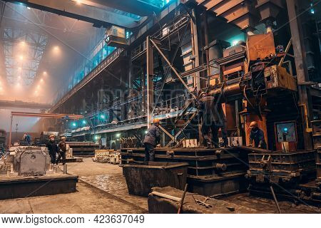 Workers Work With Molds For Smelting Iron At Steel Mill In Factory Workshop. Foundry, Heavy Industry