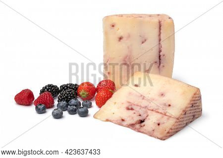 Slices of  Spanish goat cheese with red fruit syrup injected inside and fresh fruit isolated on white background