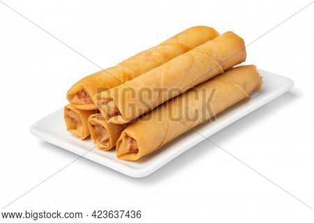 Plate with crispy deep fried Vietnamese egg rolls on white background