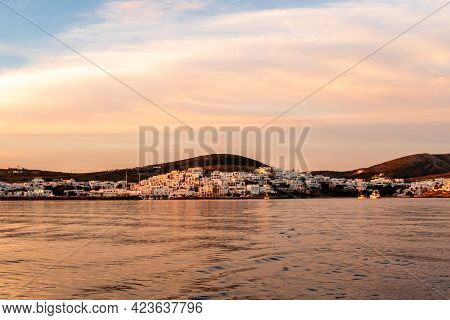 Naoussa Coastal Village On Paros Island With White Cycladic Houses In Pink Sunrise Colors And Pink C