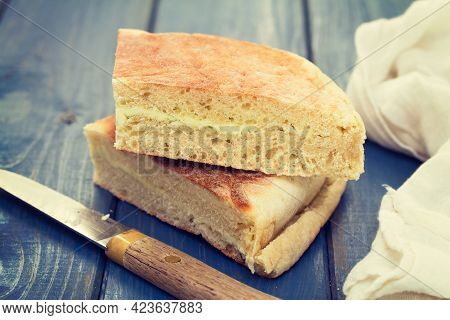 Typical Bread Of Island Madeira On Blue Background