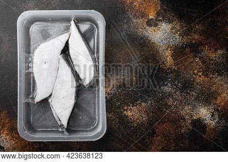 Halibut Fish Frozen Steak Pack Set, On Old Dark Rustic Table Background, Top View Flat Lay, With Cop