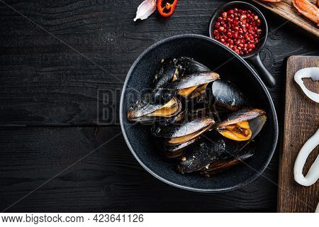 Steamed Mussels Over Black Wood Table, Flat Lay With Copy Space, Food Photo.