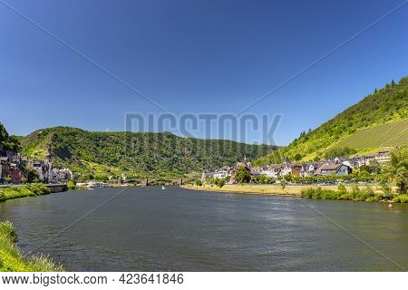 Cochem, Germany, June 13, 2021. Beautiful View Of The Colorful Buildings Along The River With A Brid