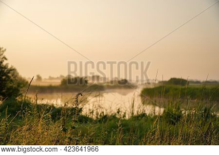 Sunrise In A Light Fog On A Small River. Selective Focus