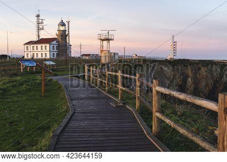 Asturias, Spain - January 26, 2019: View Of The Peñas Cape Lighthouse At Sunrise In Asturias, North