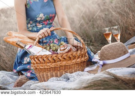 Summer - Provencal Picnic In The Meadow. Girl With A Basket On A Picnic