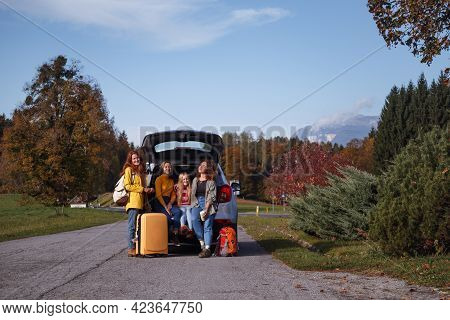 Big Family Trip - Happy Girls Travel By Car. Mamma With Daughters Sitting In The Boot
