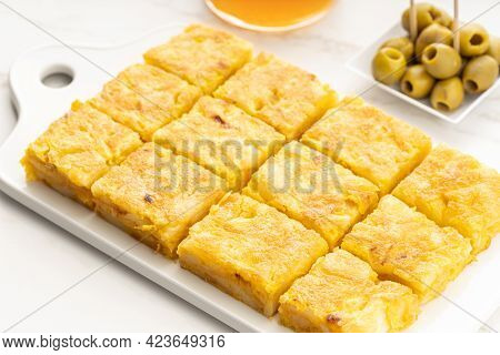 Spanish Potato Omelette Appetizer Called Spanish Tortilla On Marble Table. Typical Spanish Tapa