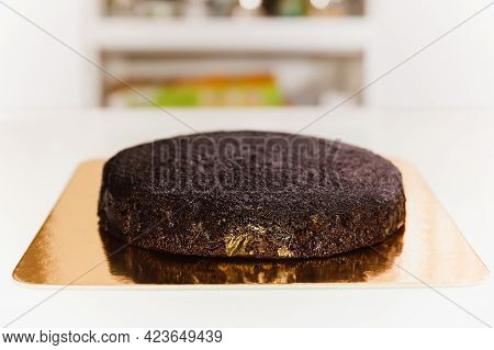 Freshly Baked Sponge Chocolate Cake With On Golden Paper Board