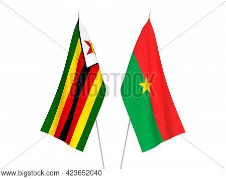 National Fabric Flags Of Zimbabwe And Burkina Faso Isolated On White Background. 3d Rendering Illust