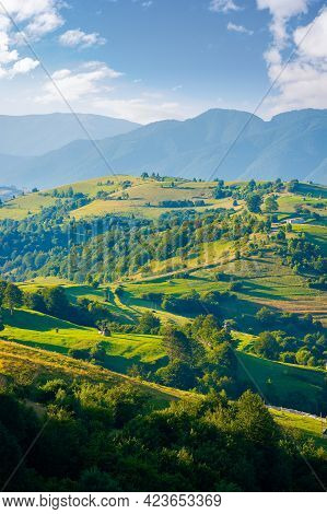 Mountainous Countryside Landscape. Hill With Trees On Rural Fields Rolling In To The Distant Ridge B