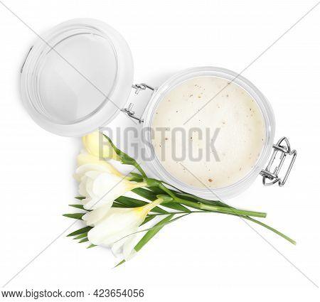 Jar Of Exfoliating Salt Scrub And Freesia Flowers On White Background, Top View