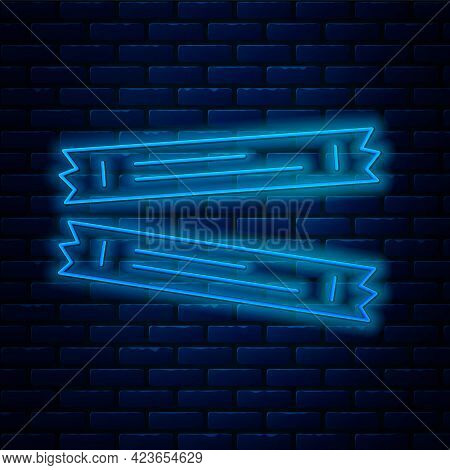 Glowing Neon Line Sugar Stick Packets Icon Isolated On Brick Wall Background. Blank Individual Packa