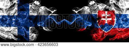 Finland, Finnish Vs Slovakia, Slovakian Smoky Flags Side By Side.