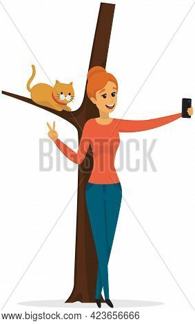 Girl Takes Selfie With Cat On Tree. Woman Is Photographed With Kitten. Lady With Smartphone Is Posin