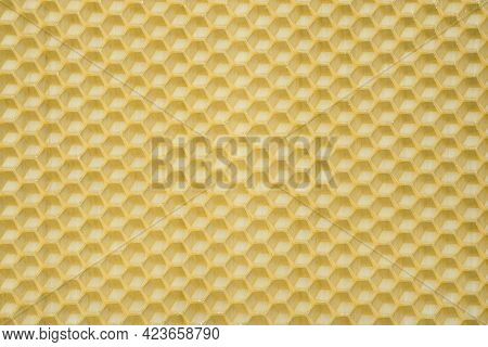 Natural Beeswax. Honeycombs Bee Background. Wax Base For Honey Bee Rebuilding.
