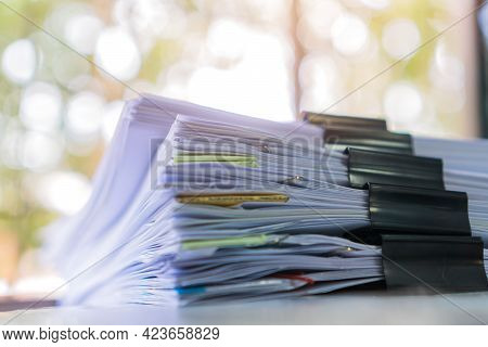 Unfinished Report Of Papers Document Folder With Black Clippaper. Pile A Lot Of Agreements Report Sh