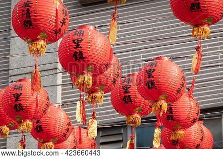 Puli Township, Taiwan -December 06, 2020: red Chinese lanterns hang up at street , Taoist special dedication sacrificial ceremony in Puli township, Nantou, Taiwan