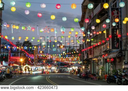 Puli Township, Taiwan -December 02, 2020: colorful Chinese lanterns hang up at street , Taoist special dedication sacrificial ceremony in Puli township, Nantou, Taiwan