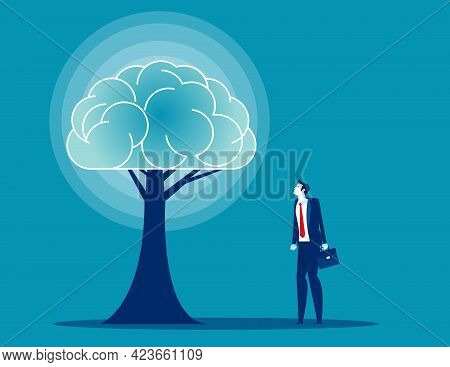 A Businessman Looking At Abstract Brain Tree In Concrete Interior