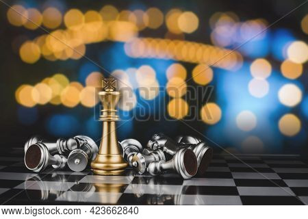 Chess Board Game With Gold King And Silver Chess Pieces On Chess Board Game Competition With Abstrac