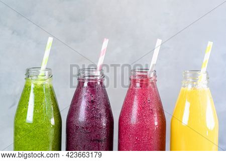 Colorful Smoothie In Glass Bottles. Summer Fruit Smoothies In Jars. Healthy, Detox And Diet Food Con