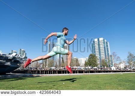 Run Fast. Energetic Guy Run Outdoors. Man Runner In Sportswear. Summer Sports. Running Jump