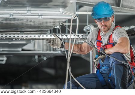 Caucasian Hvac Worker And His Job. Commercial And Residential Heating, Filtering And Air Climate Con