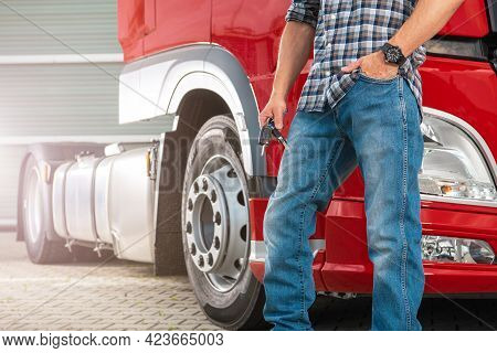 Caucasian Truck Driver In His 40s With Keys In His Hand To Brand New Semi Truck. Heavy Duty Transpor