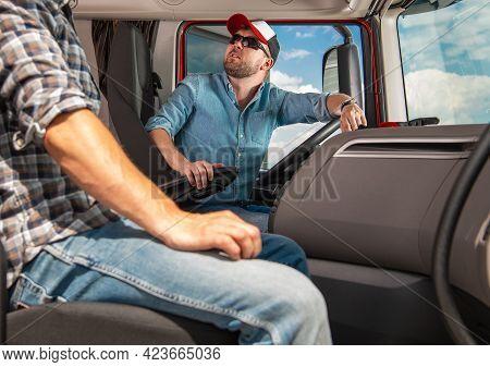 Two Caucasian Truckers International Haul Team. Semi Truck Drivers Preparing For Another Long Haul T