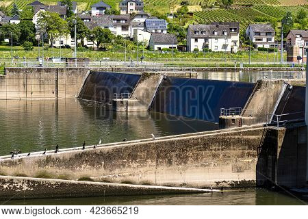 Canal Lock With A Closed Steel Gate On The Moselle River In West Germany, Dam Visible.