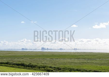 Landscape Near Pilsum With View Over The North Sea To The Dutch Coast. Pilsum Is Located In East Fri