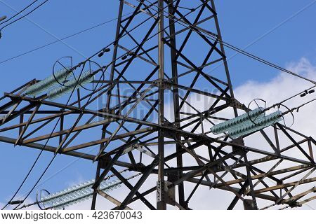 Power Line Of Cables And Insulators Close Up. Electrical Insulators Support Cables Placed On Bracket