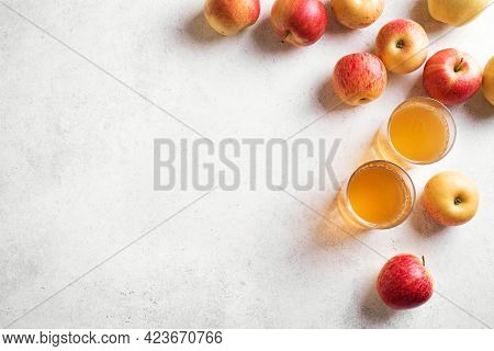 Apple Cider Or Juice Drink And Apples On White Background, Top View, Copy Space. Garden Organic Red