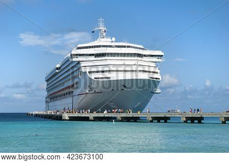 The Morning View Of A Large Cruise Liner Moored To The Pier With Many Tourists Around (grand Turk, T