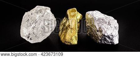 Rough Diamond Stone With Rough Gold And Silver Nuggets On Isolated Black Background.